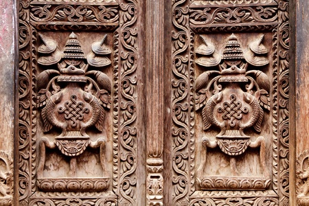 valley of the temples: wooden carved door detail Stock Photo