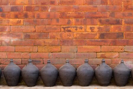 traditional pottery pots against brick wall at Bhaktapur, Nepal photo