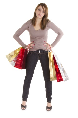 bored shopper woman with bags isolated on white Stock Photo