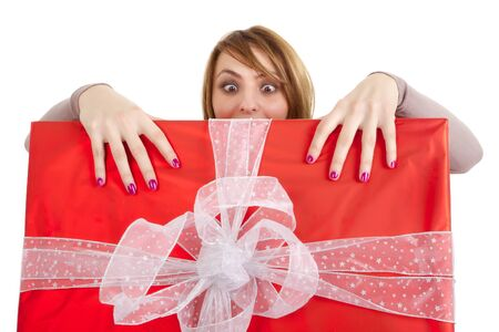 funny girl grabbing huge present isolated on white photo