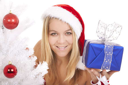 beautiful blonde wearing santa hat holding present package Stock Photo - 8458082