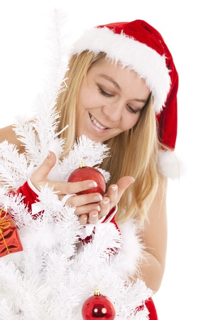 beautiful blonde girl stroking christmas tree bauble Stock Photo - 8458081