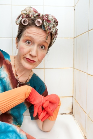 funny woman cleaner in dirty shower photo