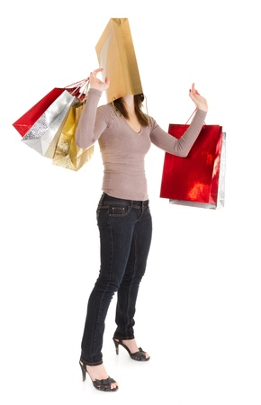 holiday stress: young  woman masked with shopping bag over white