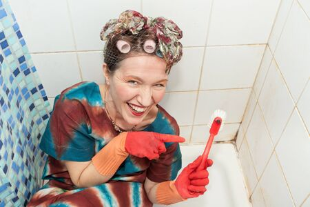 funny retro woman showing brush in shower photo