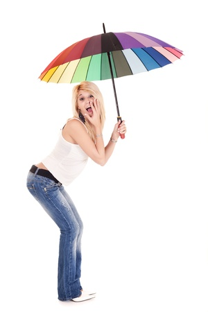sexy young woman in blue jeans holding rainbow umbrella on white background photo