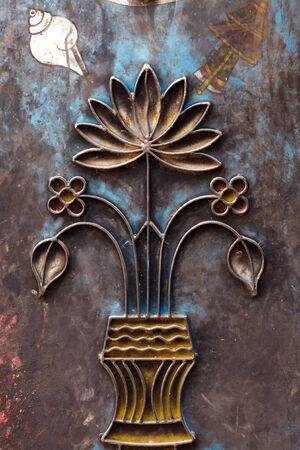 metal sculpture: hinduism metal carving of lotus flower on nepalese temple