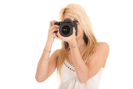 blond woman shooting picture with dslr camera photo