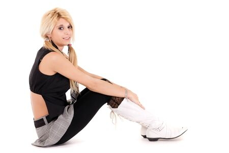 glamour schoolgirl sitting on floor isolated on white photo