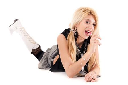 sucking lollipop: glamour schoolgirl lying on floor and sucking lollipop Stock Photo