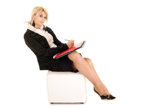 businesswoman legs: blond business woman sitting on cube isolated on white