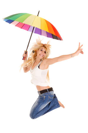 casual blond woman jumping with rainbow umbrella isolated on white photo