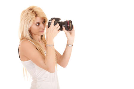 blonde woman shooting picture with dslr camera isolated on white photo