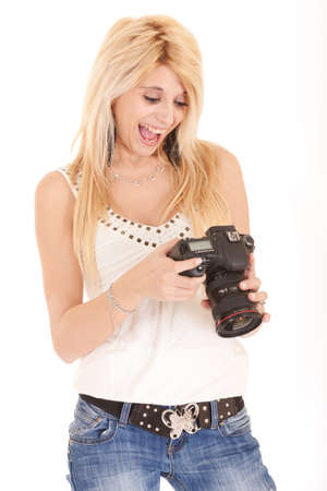 blond womanlooking picture on dlsr camera photo