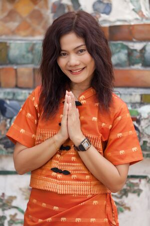 thai woman praying near temple  in traditional clothes Stock Photo - 9468790