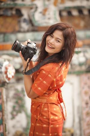 smiling asian woman using professional digita camera, Thailand Stock Photo - 9467022