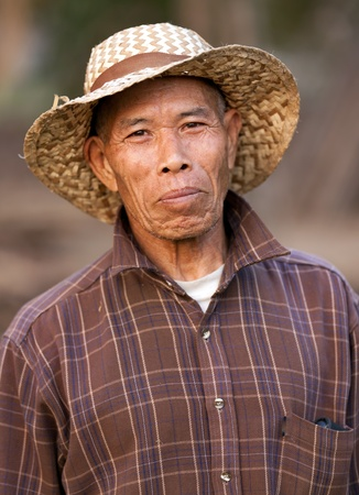 poor people: portrait of asian thai farmer in chiang rai province, Thailand