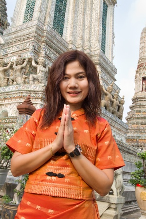 religious clothing: thai woman in traditional clothes praying in wat arun temple, bangkok,thailand