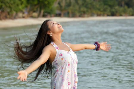 happy young asian woman breathing at sea, thailand Stock Photo