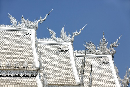 buddhist temple roof: beautiful white buddhist temple roof in chian rai, thailand