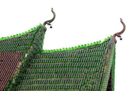 buddhist temple roof: buddhist temple roof made of empty glass bottle isolated on white, thailand Stock Photo