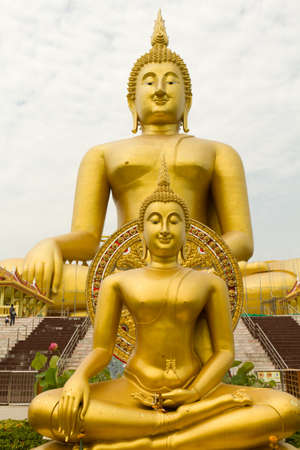 two large giant buddha statue at wat muang temple, thailand photo