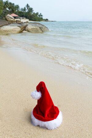 santa claus hat on tropical beach, thailand photo