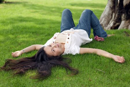 asian woman  lying on fresh grass at spring Stock Photo - 9736571