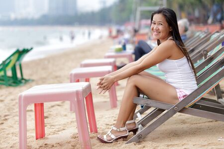 asian woman relaxing sitting on beach, Pattaya, thailand photo
