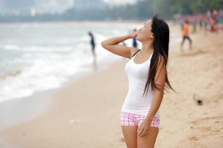 beautiful young asian woman standing on beach, pattaya, thailand Stock Photo - 9736557
