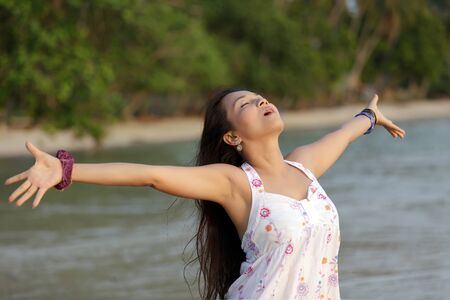 breath: asian woman breathing in thailand tropical beach