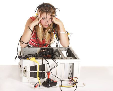 computer cable: bored blond woman trying to repair broken computer