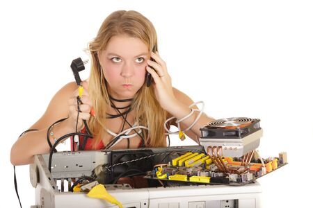 motherboard: bored woman calling technical support to repair computer Stock Photo