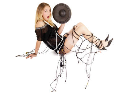 rca: woman covered with electric plugs and cables holding big woofer