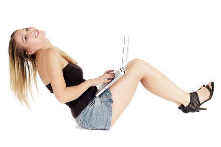 sitting woman bending and typing on keyborad laptop photo