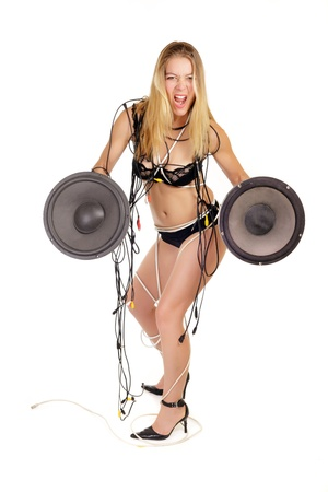 woman in lingerie holding huge stereo woofer isolated on white photo