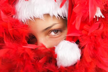 pompon: funny  portrait of  santa woman  hidden in red boa feathers