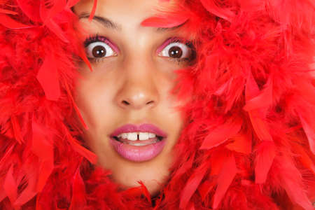 portrait of woman beauty in vivid red feather photo