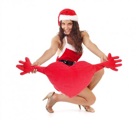 beautiful woman in santa claus clothes holding heart symbol photo
