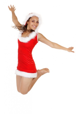 happy  santa woman jumping isolated on white background photo