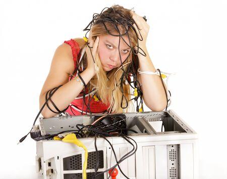 desperate woman trying to repair broken computer