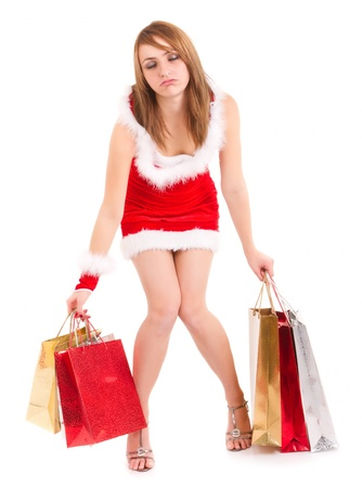 exhausted young woman in santa suit carrying shopping bags photo