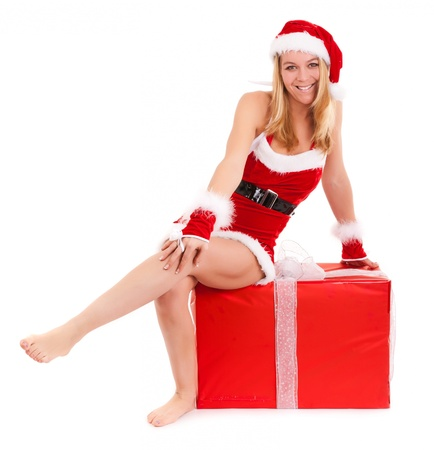 christmas woman sit on huge gift isolated on white Stock Photo
