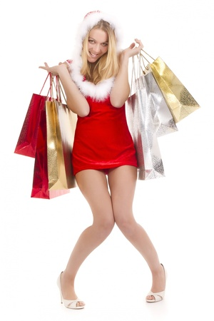 excited  young woman in santa suit carrying shopping bags photo