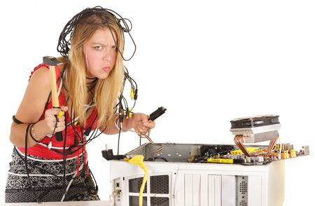 upset woman breaking computer with hammer photo