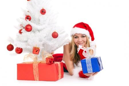 christmas woman lying on floor holding gift beside tree Stock Photo - 10262991