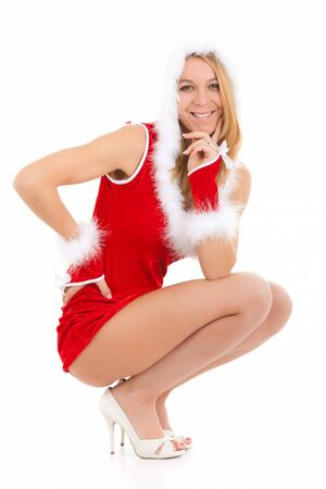 sexy christmas woman posing over white background photo