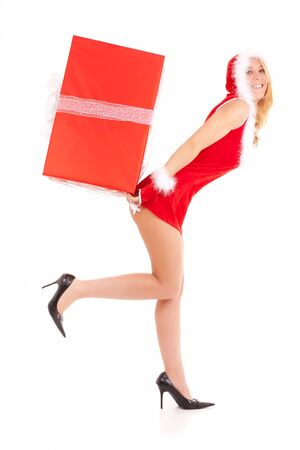 christmas woman carrying big gift on back photo