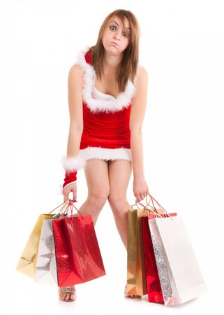 exhausted young woman in santa suit carrying shopping bags Stock Photo - 10299162