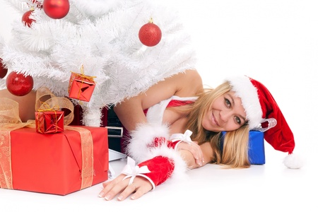 christmas woman lying on floor among gift Stock Photo - 10414821